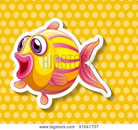 Closeup yellow fish on yellow polkadot background