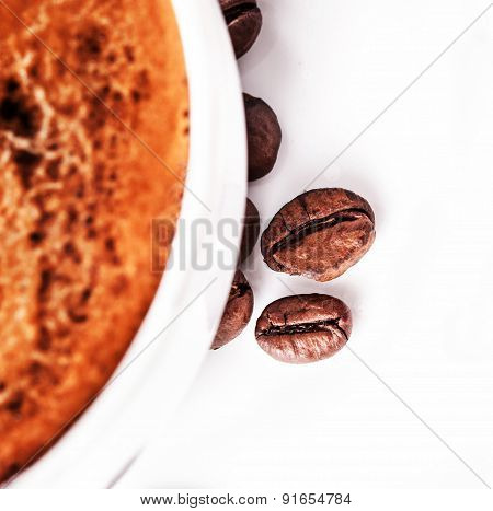 Coffee Cup And Saucer With Roasted Coffee Beans Isolated On A White Background