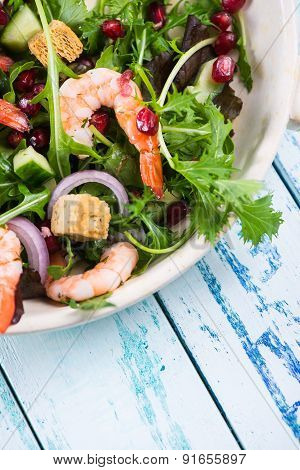 Healthy Salad With Seafood And Pomegranade In Rustic Bowl