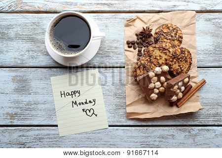 Cup of coffee with fresh cookies and Happy Monday massage on wooden table, top view