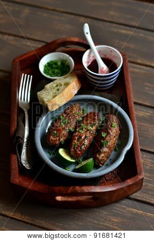 Kebabs On Wooden Tray With Cranberry Sauce