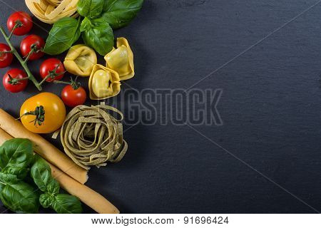 Selection Of Italian Tipical Food On Black Background From Above