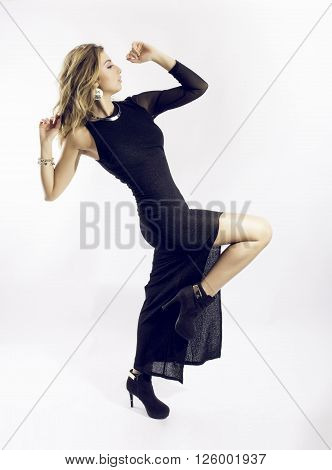 chiara model dance in photo studio with long black dress