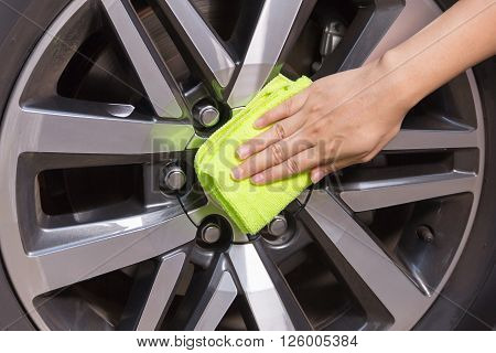 A woman hand with yellow microfiber cloth cleaning big max car, car concept, car idea, car housework, car cleaning , car washer. poster