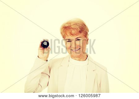 Happy elderly business woman holding eight billard-ball
