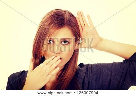 Shocked teenage woman overhears conversation