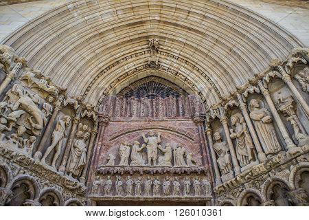 The tympanum of Christ redeemer (Cristo Redentor) in the principal facade of San Bartolome church in Logroño La Rioja. Spain.