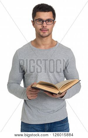 Handsome young man reading a book isolated on white