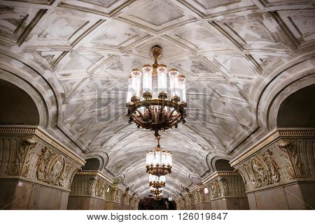 MOSCOW - MARCH 3: Chandeliers in Prospekt Mira metro station on March 3, 2016 in Moscow. The ceiling vault is decorated with casts, and lighting comes from several cylindrical chandeliers.