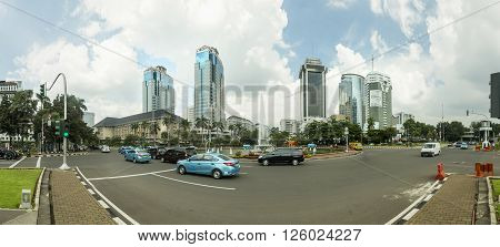 Jakarta Indonesia - March 17 2016: Jakarta Indonesia capital city is a mixed of modern buildings with villages like housing structure right in the center of the city