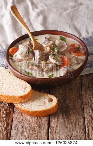 Beef With Mushrooms In Cream Sauce In A Bowl. Vertical