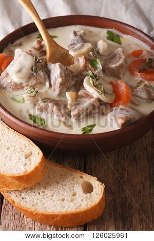 Veal With Mushrooms In Cream Sauce In A Bowl. Vertical