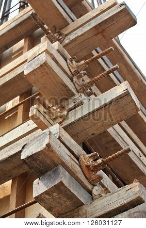 PERAK, MALAYSIA -OCTOBER 27, 2015: Connector detail, binder, wood and installation methods form work on a construction site.