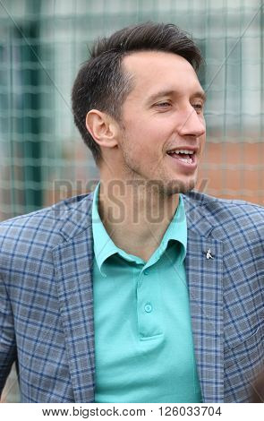 KYIV UKRAINE - APRIL 16 2016: Sergiy Stakhovsky ATP player from Ukraine one of the guests of BNP Paribas FedCup World Group II Play-off game Ukraine vs Argentina at Campa Bucha Tennis Club in Kyiv