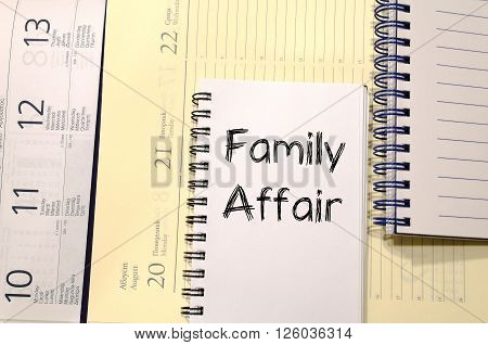 Family affair text concept write on notebook