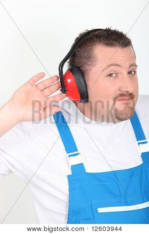Portrait of a worker with noise-canceling headphone