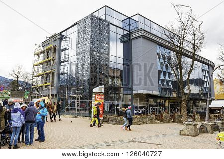 ZAKOPANE POLAND - MARCH 06 2016: The construction of a modern shopping mall work began in late 2011 then stopped and re-started in September 2014 now is close to completion of the works