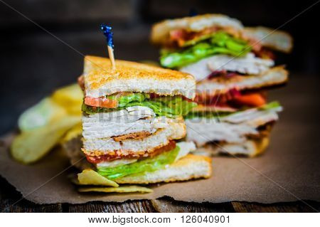 Image of Club Sandwich On Rustic Wooden Background