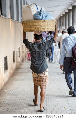 Man Carrying Weight