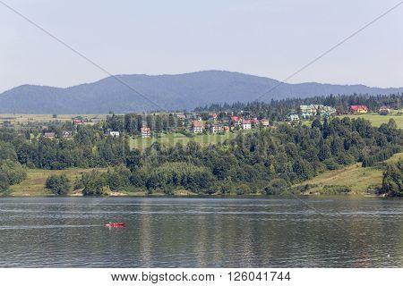 Lone canoeist on the lake Czorsztynskie in Pieniny Mountains, Poland