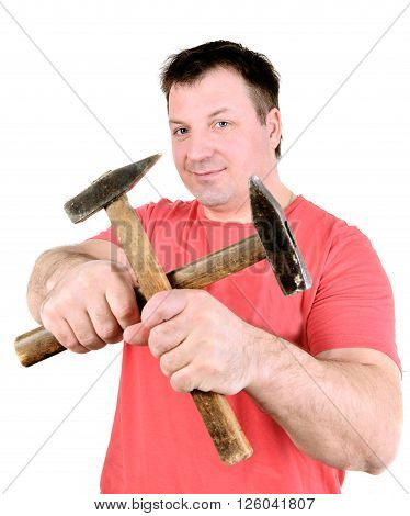 Worker man holding hammers. Isolated on a white background.