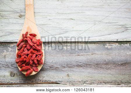 Image of Goji Berries On Wooden Background