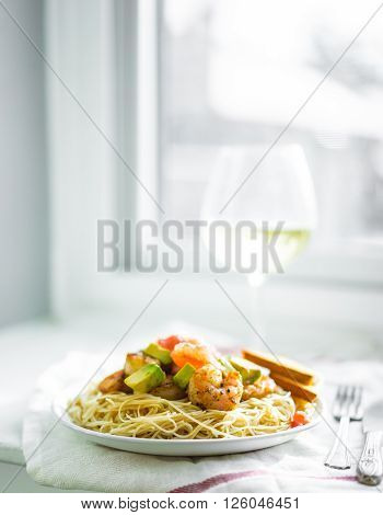 Image of pasta with shrimps on white background