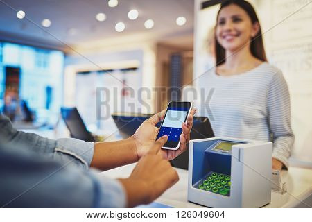 Close Up Of Payment With Cell Phone