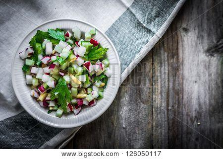 Image of vegetable salad on wooden background