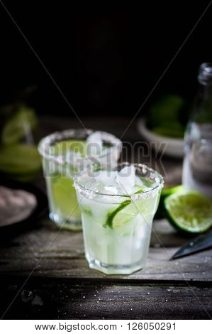 Water With Ice And Limes On Rustic Background