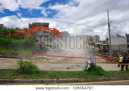 Quito, Ecuador - April, 17, 2016: House destroyed by Earthquake with rescue team and heavy machinery in the south part of the city.
