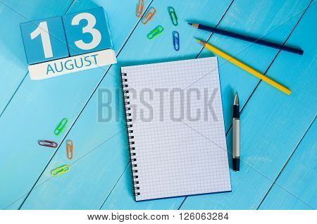 August 13th. Image of august 13 wooden color calendar on blue background. Summer day. Empty space for text. International Left Handers Day.