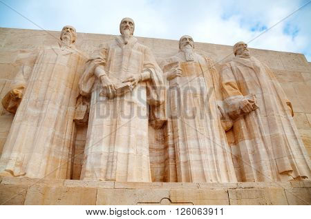 GENEVA SWITZERLAND - NOVEMBER 28: The International Monument to the Reformation (Reformation wall) with the statues of William Farel John Calvin Theodore Beza and John Knox on November 28 2015 in Geneva Switzerland.