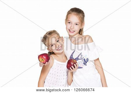 Beauty young girls with fresh apples. Healthy lifestyle. Happiness. White background.