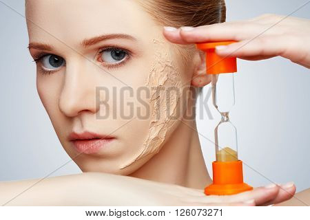 beauty concept rejuvenation renewal skin care and skin problems with hourglass
