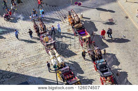 Crowded Stephansplatz In Vienna, Austria With Fiakers