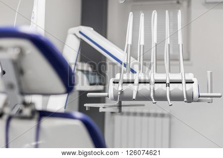 modern dentist tools burnishers view behind patient seat