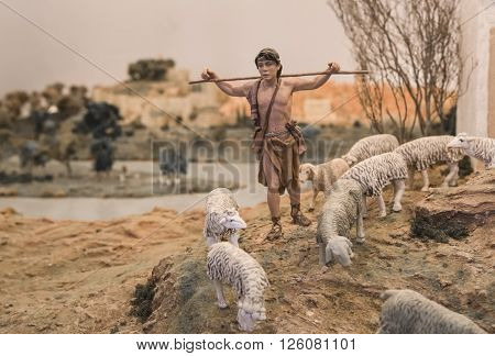 Badajoz Spain - January 4 2013: Young Shepherd at rise. Diorama built by Local Association of Friends of Cribs Badajoz 2013