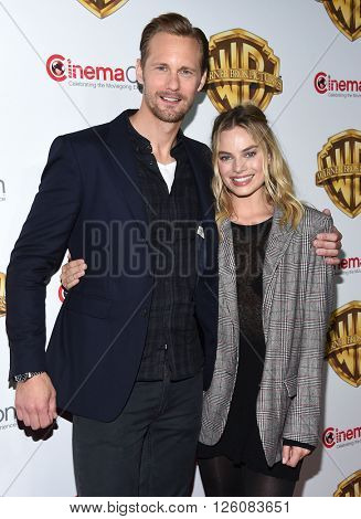 LOS ANGELES - APR 12:  Alexander Skarsgard & Margot Robbie arrives to CinemaCon 2016: Warner Bros.