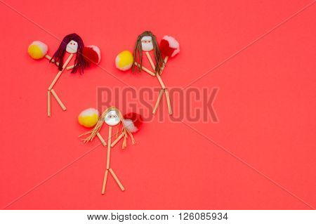 Cheerleader button head stick figure girls.  Yellow and red pompoms
