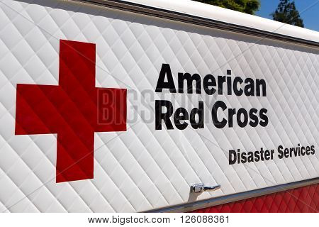 ARCADIA CA/USA - APRIL 16 2016: American Red Cross Disaster Services vehicle and logo. The American National Red Cross is a humanitarian organization that provides emergency assistance in the United States.
