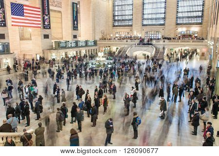 New York - March 21, 2013: Time lapse photo of commuters in motion and standing still, in Grand Central Terminal.