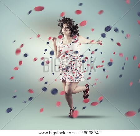 Girl wear a dress with dots and while she dance the dots come off.