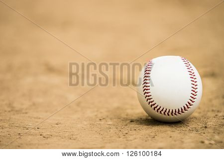 close-up baseball on the infield, sport background