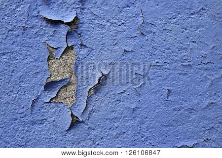 blue exfoliated facade paint on a wall