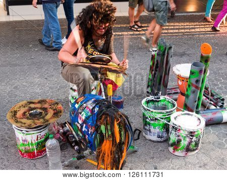 SAN JOSE, COSTA RICA - April 9: Street musician playing his homemade drummer on the busiest street of Costa Rica. April 9, 2016 in San Jose.
