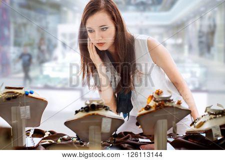 Beautiful Girl Choosing Jewelry In Shop