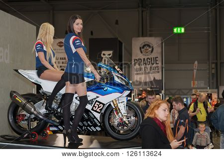 BRNO ,CZECH REPUBLIC-MARCH 4,2016: Beautiful hostesses present motorcycle BMW S 1000 RR on International Fair for Motorcycles on March 4,2016 in Brno in Czech Republic