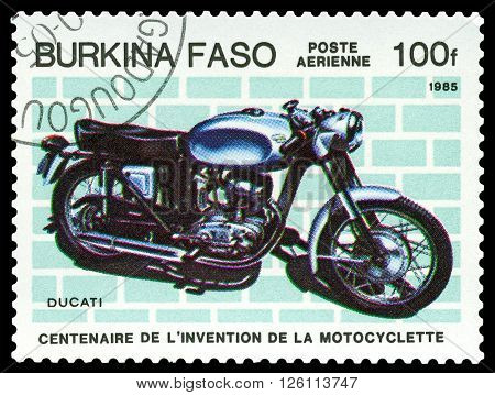 STAVROPOL RUSSIA - MARCH 16 2016: a stamp printed in Burkina Faso shows old motorcycle Ducati stamp devoted to the centenary of the invention of motorcycle circa 1985