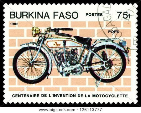 STAVROPOL RUSSIA - MARCH 16 2016: a stamp printed in Burkina Faso shows an old motorcycle Pope stamp devoted to the centenary of the invention of motorcycle circa 1985